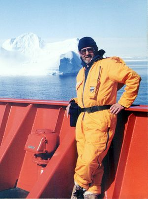 Ian Jacobsen takes in the view from a vessel in Antarctic waters.