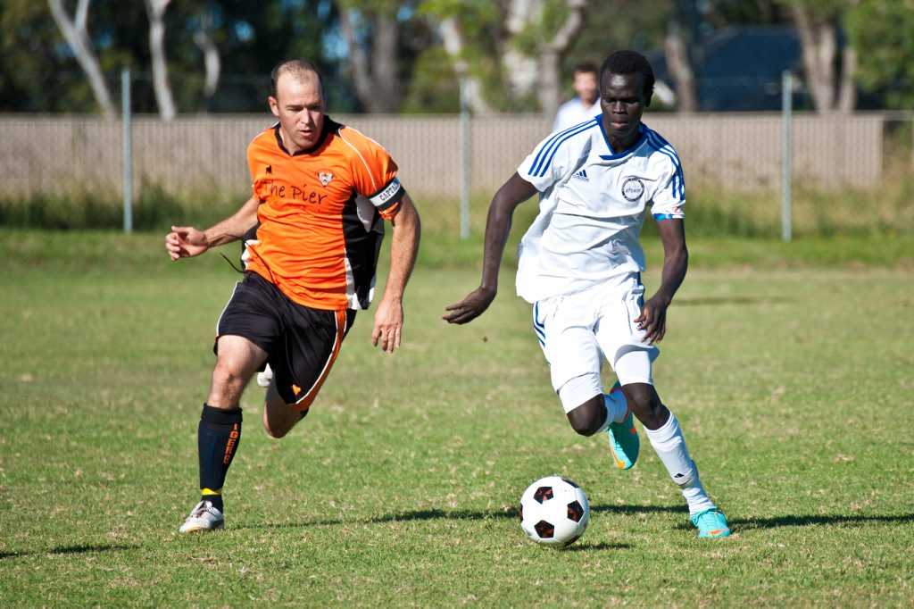 Soccer, Storm vs Tigers at Kororo: Storms Mohammed Abdul Fetah gets some close attention from the Tigers. Photo: Rob Wright / The Coffs Coast Advocate