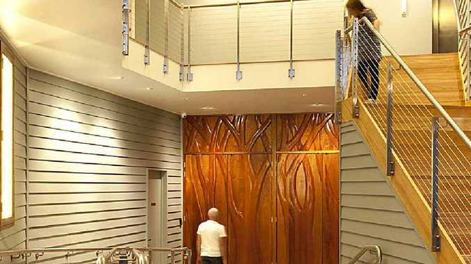 INNOVATION: Hand-carved Wootha red cedar entry doors are a feature of Maleny Community Centre.
