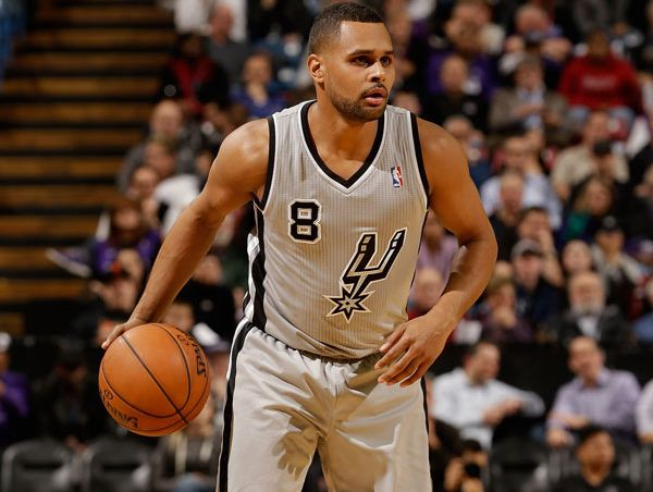 Patty Mills #8 of the San Antonio Spurs in action against the Sacramento Kings at Sleep Train Arena on February 19, 2013 in Sacramento, California.