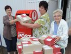 Fay Stuhmcke, Debbie Joynson and Mary Slater with care packages to be sent to soliders serving in Afghanistan who have a link to the Fraser Coast.