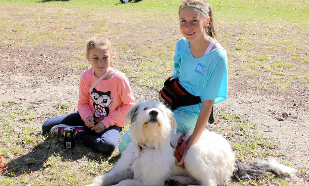 Maddi Russell and Olivia Dickson with Spud take a quick rest during the RSPCA Million Paws Walk.