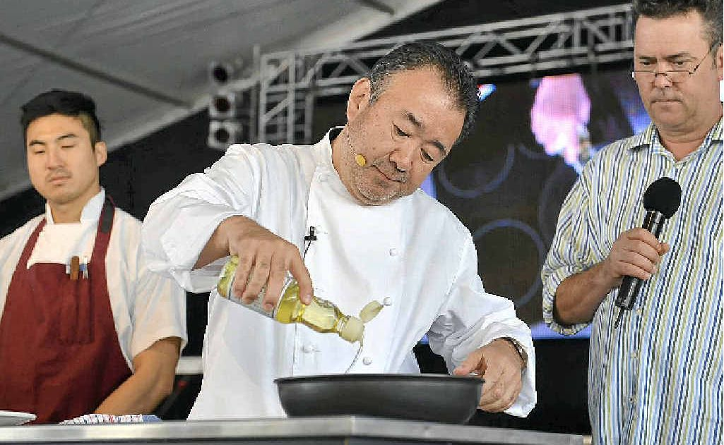 Tetsuya Wakuda puts on a show for the crowd at the Noosa Food and Wine Festival.