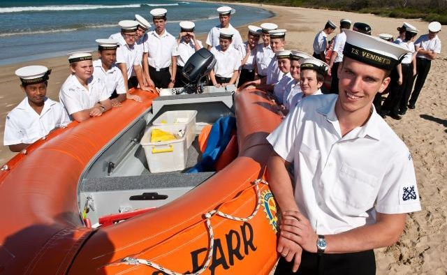 Coffs Harbour Royal Australian Navy cadets inspect one of the unit's new safety boats.
