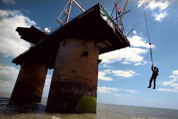 The only way up to the micro island of Sealand is by a swing seat suspended by a winch.