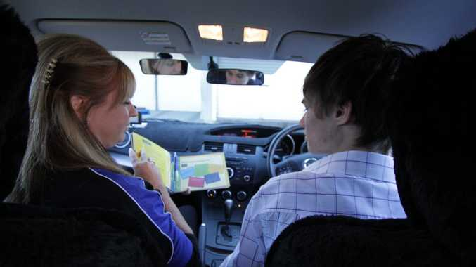 Driving instructor Chris McFarlane with learner driver Ryan Behrendorff. Photo: Robyne Cuerel / Fraser Coast Chronicle