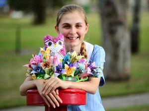 """Origami girl"" folds up random gifts of love"