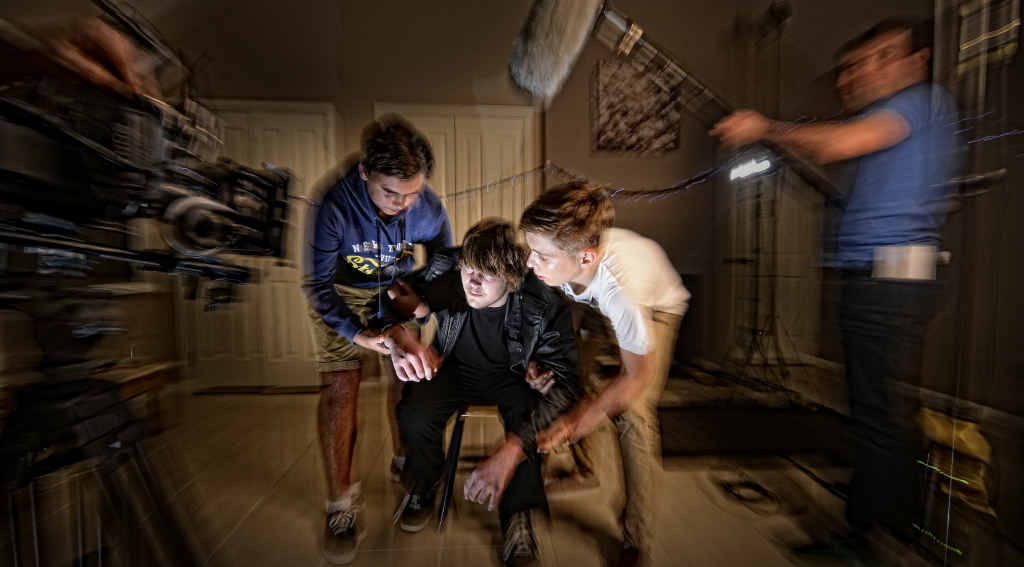 ACTION: McAuley students Jaxsom Smyth, Alex McPhillips and Bryce Ellis act out a scene as part of alcohol awareness Eyes Wide campaign being filmed using drama students from McAuley and South Grafton High schools. Photo: Adam Hourigan