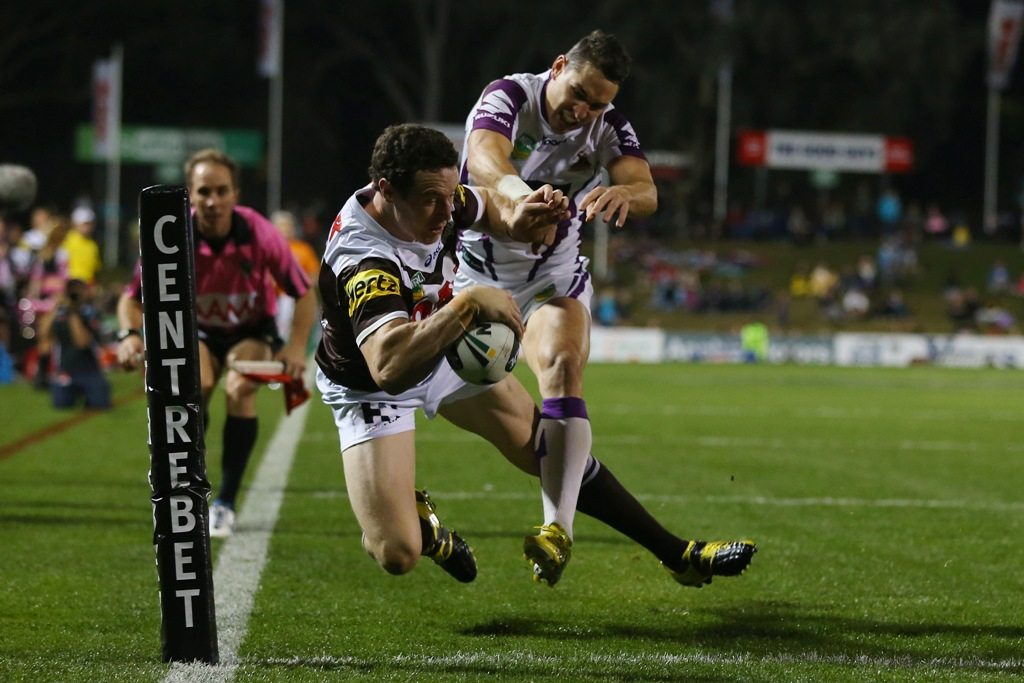 David Simmons of the Panthers beats the tackle of Billy Slater of the Storm to score a try during the round nine NRL match between the Penrith Panthers and the Melbourne Storm at Centrebet Stadium on May 12, 2013 in Penrith, Australia.