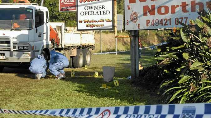 Forensic officers inspect the area where Dale Frances Owens stabbed workmate James Costello in July 2011. The two worked for Queensland Rail and were in Mackay for a job, staying at the Northview Motel, where the attack occurred.