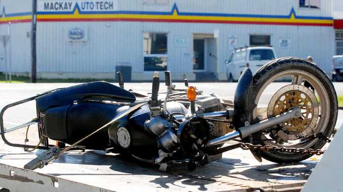 The motorcycle involved in a crash at the intersection of Tennyson and Victoria Streets is taken from the scene.