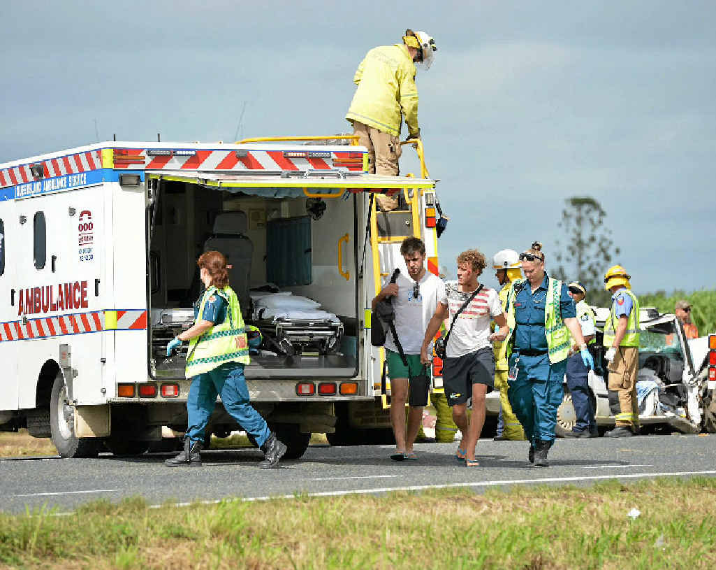 INJURED: Italian tourists walk to an ambulance for treatment after a crash near Chelona on May 10. Five other people, including Enrico Pancher, were taken to hospital.