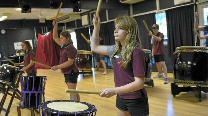 BOOMTOWN: Michaela Buccholz,13, Kayla Channel, 12, Chloe Long, 14, Charmaine Brady, 14, Bradley Read, 12 and Kaitlyn Read, 14 from Toolooa State High rehearse on the Taiko drums.