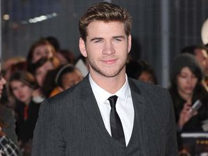 Liam Hemsworth fights off ladies at Cannes film festival
