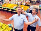 BACK IN BUSINESS: IGA Cornetts store manager Trevor Schulz and Terry Schiffke celebrate the reopening of the store after the 2013 flood. Photo: Max Fleet / NewsMail