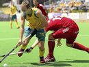 MACKAY hockey player Matthew Swann is putting celebrations on hold after helping his team win the prestigious Euro Hockey League champions trophy.