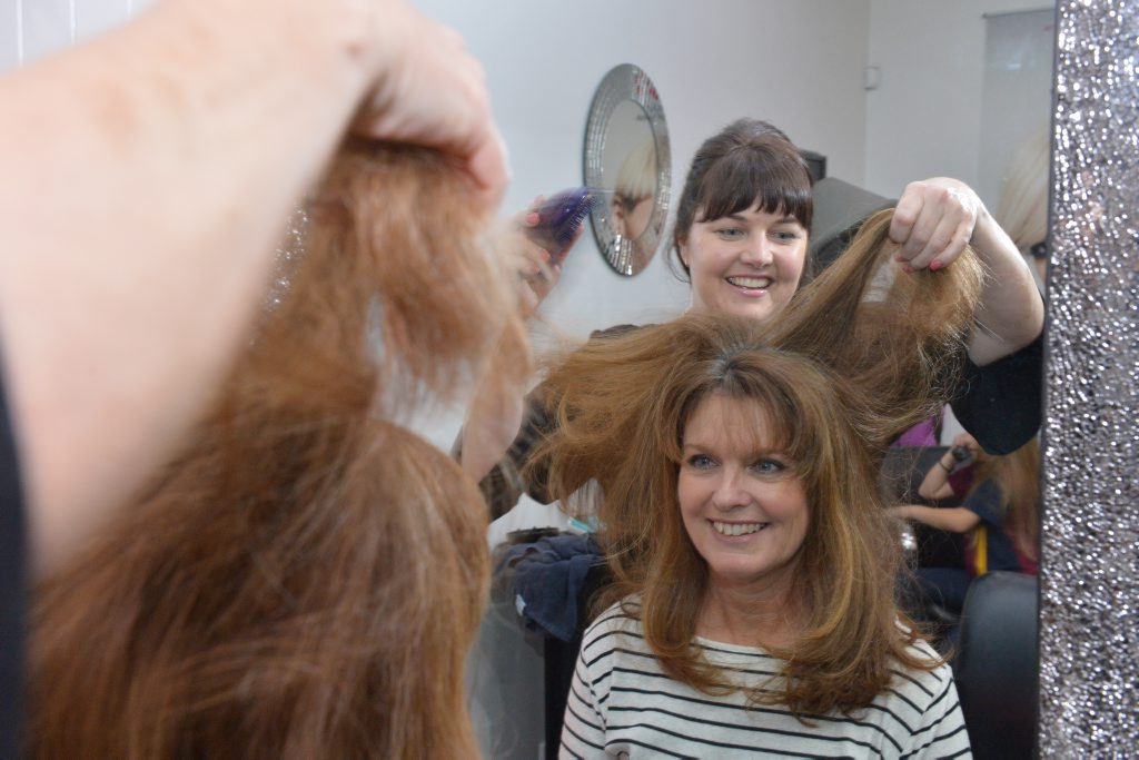 Paula Glover and Yvette McKenna (standing) of Hair on Maple are amazed that 91% of Australians think hair is a key part of their sex appeal. Photo: John McCutcheon / Sunshine Coast Daily