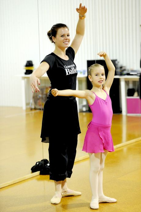 Queensland Ballet education squad instruction Alice Hall with seven-year-old Chloe Earnst.