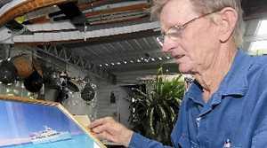 Bob Evetts looks at a photo of the Elizabeth E ii.