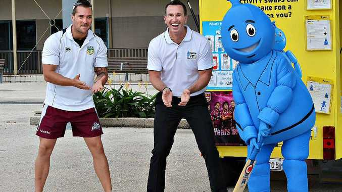 Mackay NRL Development Officer Tyson Muscat left, joined Duncan Armstrong and Eric, the mascot in a quick game of cricket at the Mackay Bluewater Quay.