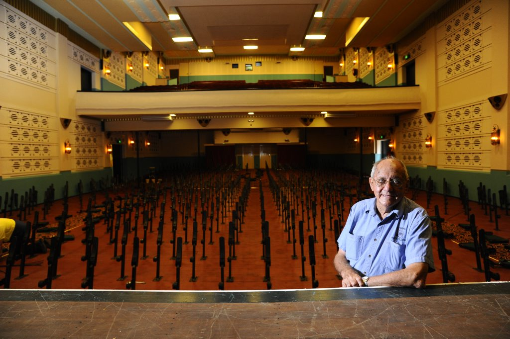 Spiro Notaras in the main cinema at the Saraton theatre. Spiro had all of the cushions from the chairs removed in preparation for if the floodwaters topped the levee bank. Photo JoJo Newby / The Daily Examiner