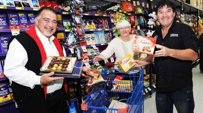 Pialba Super IGA owner Brett Leishman and Bayside Transformations' Chris Gollop and Darren Yates test out the two-minute grocery grab prize.