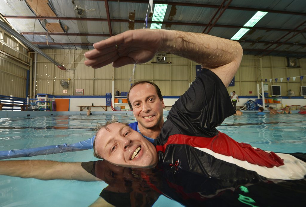 IN THE SWIM: Raymond Bruckner is learning to swim at McMahon's Swim Factory with the guidance of instructor and general manager Tony Mammous.