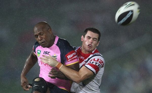 Robert Lui wearing a pink jersey for the women in league round of the NRL.