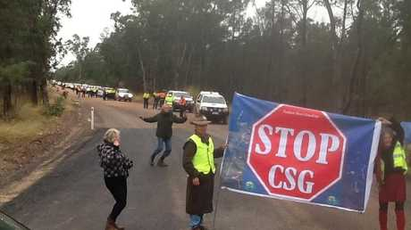 Protestors attempt to stop coal seam gas workers leaving their camp near Chinchilla.