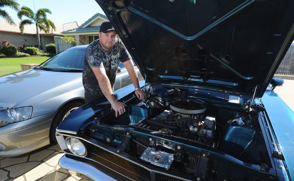 Ford owner Ash Brown with his 2004 VA Falcon and 1970 XY Falcon.