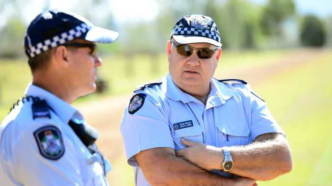 Police officers Senior Sergeant Gareth James (right) and Constable Patrick Hines at the property near Atkinson Dam were a powered paraglider operator crashed and was killed on Sunday morning.