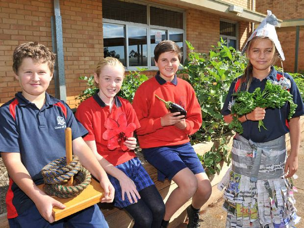 HEALTHY GROWTH: Lachlan Rayner, 11, Mikayla Nelson, 10, Digby Mercer, 12 and Araucaria Velasco, 11, from the class of 5/6 W at Alstonville Public School, in front of their school garden, getting ready for Word Environnment Day Fair.