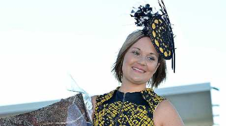 Fashions on the Field winner Jessica Smith was a stand-out in black and yellow, worn with a matching fascinator and simple black clutch and heels.