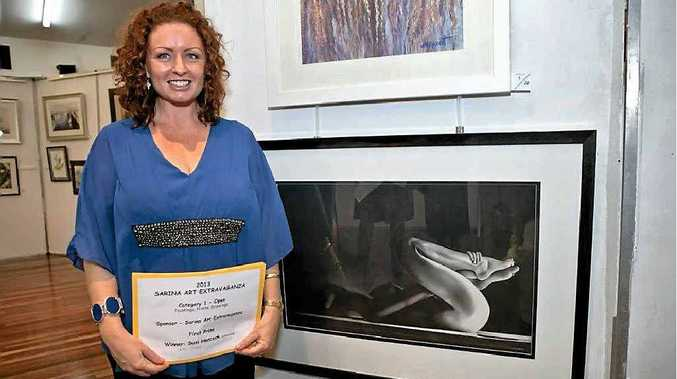 Suzi Hancock with her winning art work Curves. The Whitsunday artist won three awards at the Sarina Art Extravaganza, which opened on Friday night. The exhibition, at the Bob Wood Memorial Hall, will run until 1.30pm Saturday.