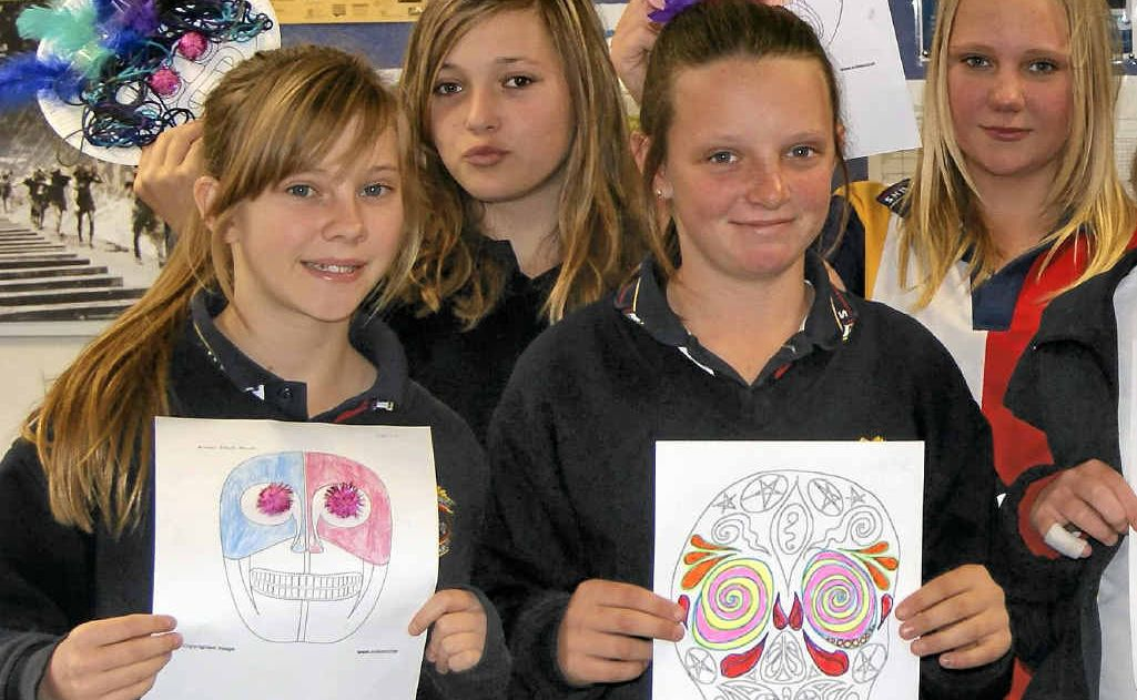 Rebecca Washbourne, Bryanna Stather, Chloe Shultz and Jazmine Dillon with their Aztec masks.