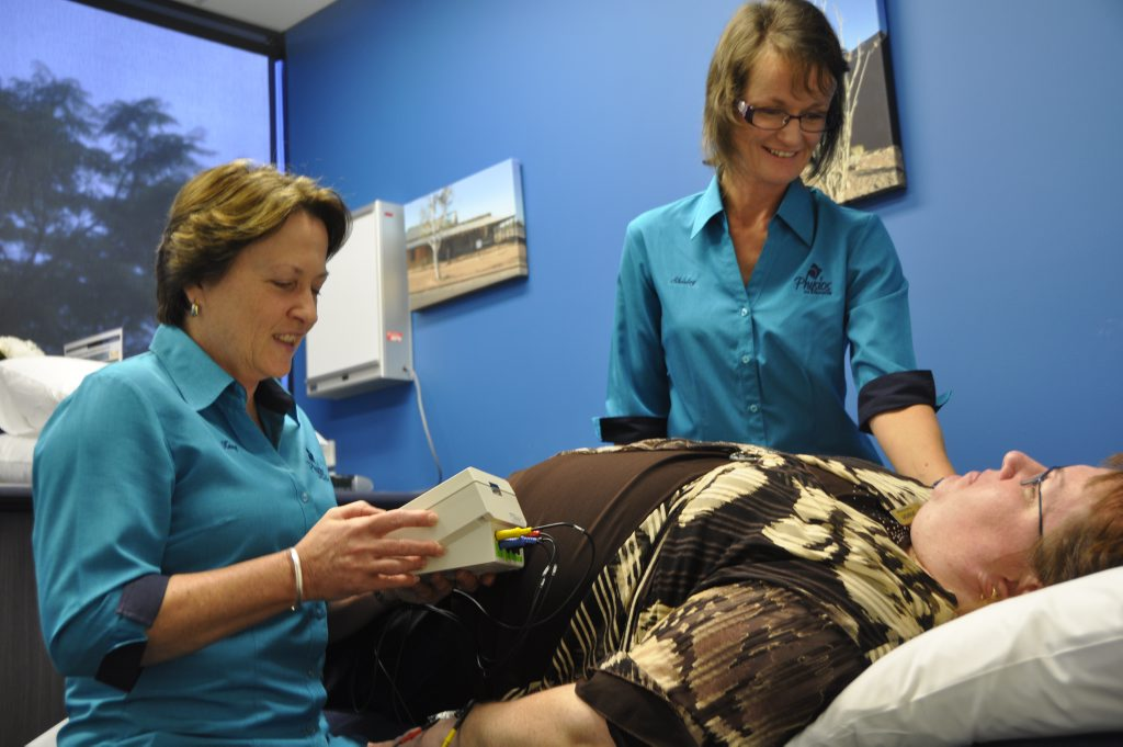 Testing out the new lymphedema machine are (from left) Kerry Burrows, Shirley Bauswer and Sharon Stokell (patient). Photo Kate Dodd / The Chronicle
