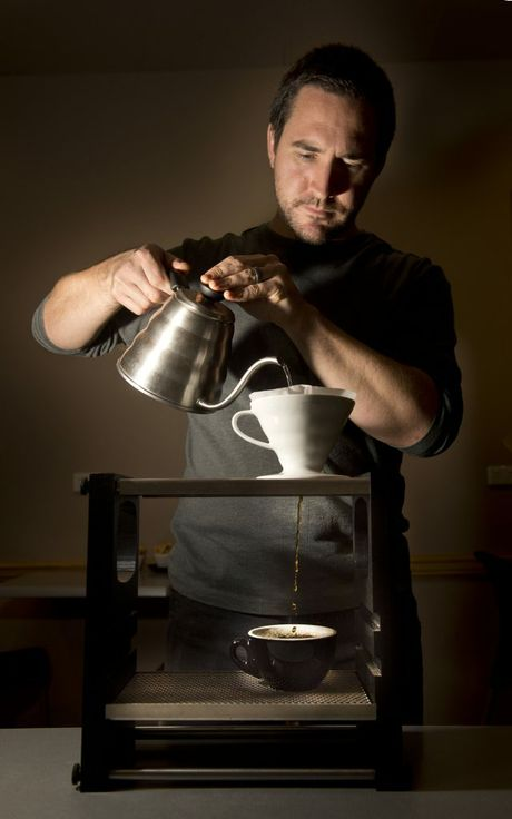 Findo's Cafe owner Tim Burstow prepares a pour over coffee.