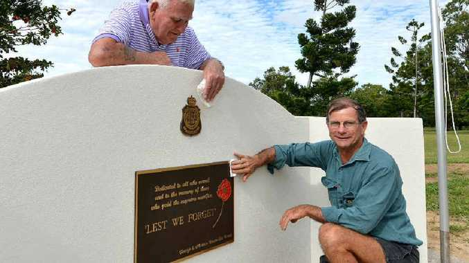 Farleigh Northern Beaches RSL Sub-branch past-president Ron Bassan and current president Russell Flor put the finishing touches to a new memorial at Bucasia.
