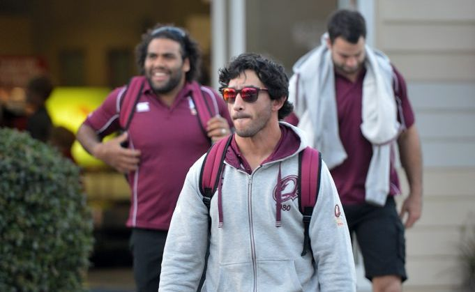 Queensland State of Origin players arrive at the Sunshine Coast Airport. Johnathan Thurston (foreground) with Sam Thaiday and David Shillington (background).