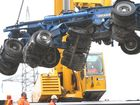 Workers remove the rear section of a long load that crashed into the safety rail on the Neville Hewitt Bridge. Photo Allan Reinikka / The Morning Bulletin