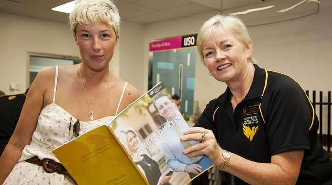 Registered nurse Erica White of Torquay talks with USQ nursing lecturer Julie Martyn at USQ's January Information Day about doing a Masters of Medicine.