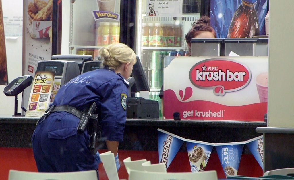Police search for clues after an armed robbery at KFC Coffs Harbour South on Tuesday night. Photo: Frank Redward