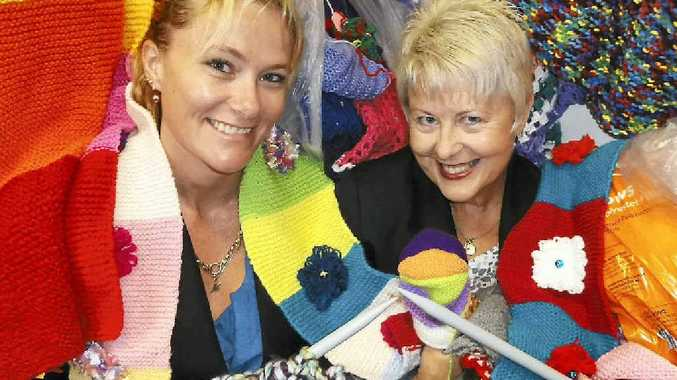 """FULL OF WOOL: Canegrowers Mackay employees Michele Morgan (left) and Julie Watson get into the spirit of the Canegrowers Network and Canegrowers Mackay joint community """"woolly"""" project bound for Sugar Court at this year's Mackay Show."""