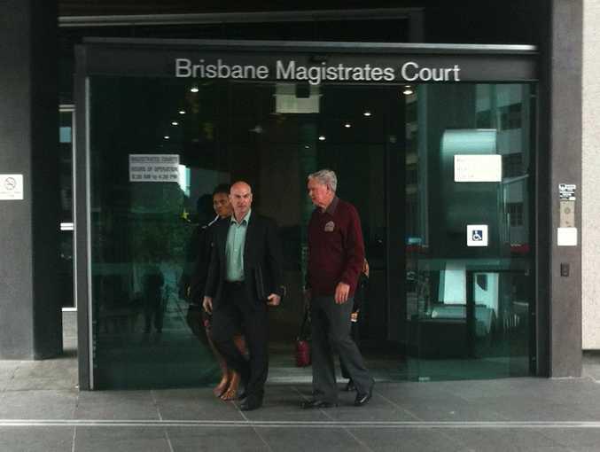 Cameron Pratt (green shirt), father of Jake Garrett-Pratt, leaves Brisbane Magistrates Court.