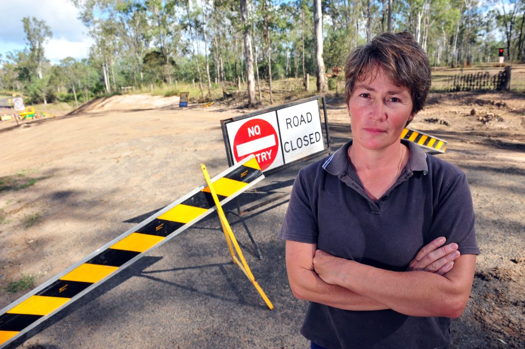 LOAD LIMIT: Sandy Brown is upset by the heavy vehicles wrecking the by-pass that goes past her house as a detour around St Agnes Bridge. Photo: Max Fleet / NewsMail
