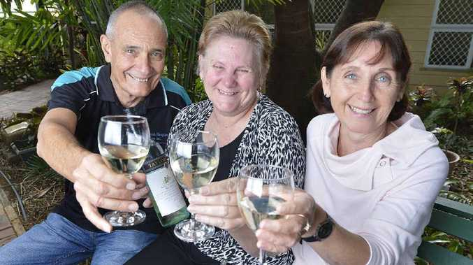 CHEERS: Bill Williams, Theresa Laimer and Jenny Sellars raise a glass for Ipswich Hospice's upcoming wine tasting fundraiser.