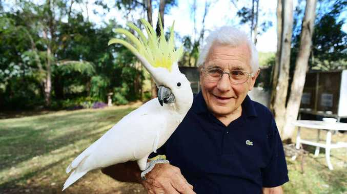 PRETTY BOY: Terry White of Redbank Plains with his nine-year-old pet cockatoo Casper.