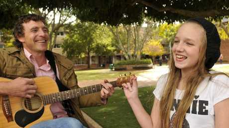 Josh Arnold with Shavonne Staines, a student at the Tara Shire State College, performing her song Living in the Country.