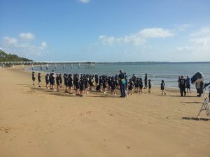 Xavier schoolchildren welcome the whales in a beach ceremony