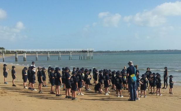 More than 40 Xavier Catholic College children gathered on the beach at Scarness for the whale welcoming ceremony.